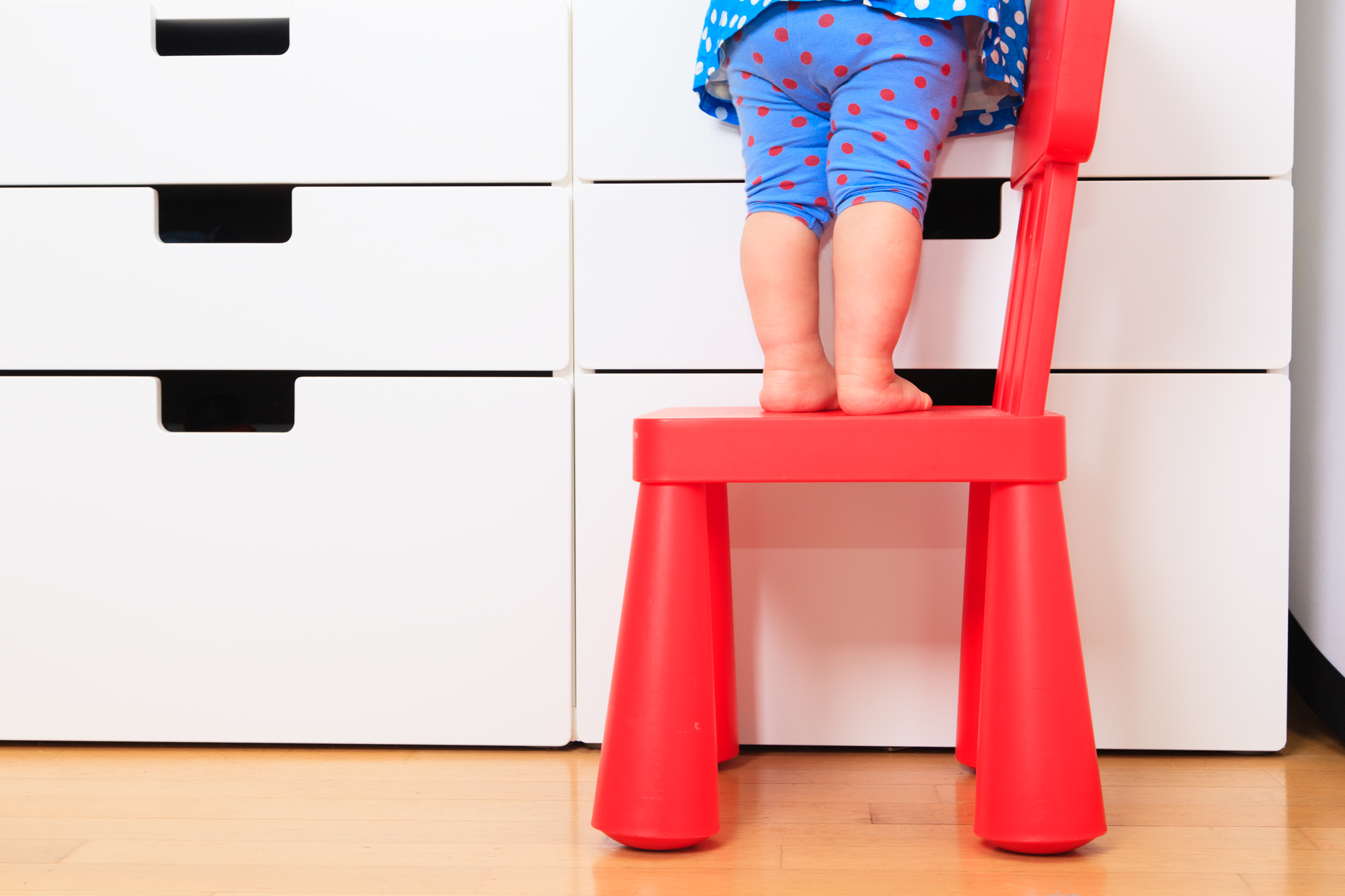 child standing on step-stool